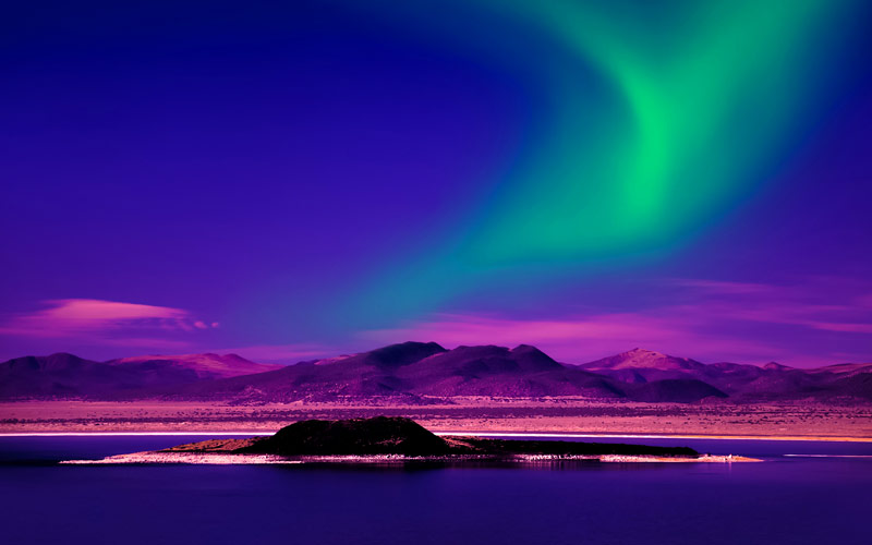 Northern Lights over lake in Greenland