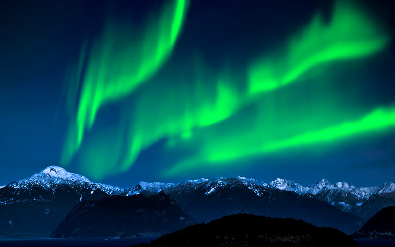 Northern Lights over Mountains and lake