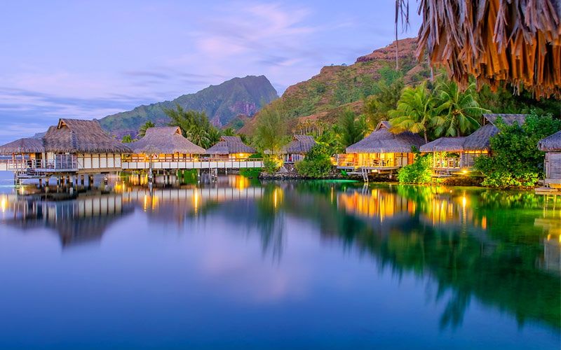 Over water bungalows at dusk French Polynesia