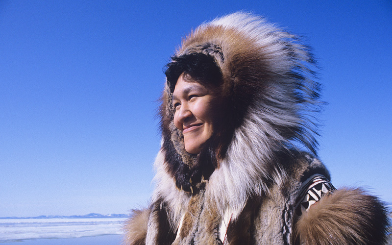 Smiling Eskimo woman wearing traditional clothing