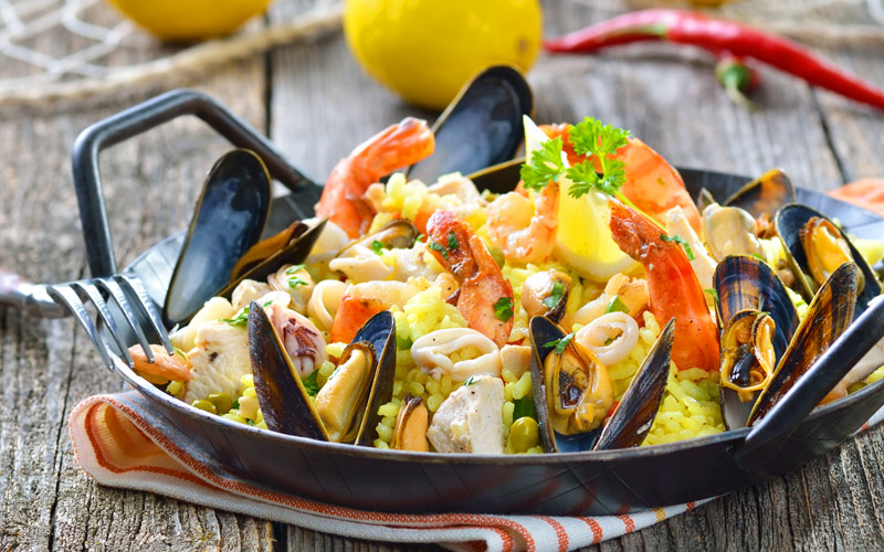Tasty Spanish paella with seafood and chicken