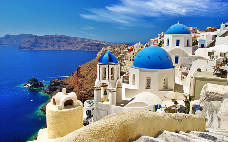 White blue Santorini view of Caldera with Domes