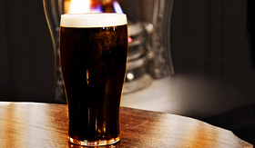 Azamara Club Cruises irish black beer shot inside a Dublin pub