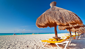 Caribbean beach with straw umbrellas