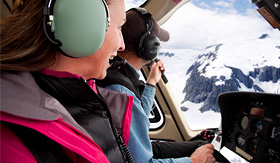 Celebrity Cruises couple enjoying a helicopter tour over Alaska