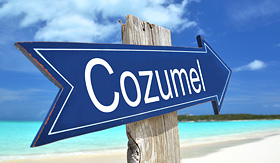 Celebrity Cruises Cozumel sign on the beach