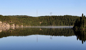 Crystal Cruises calm water and mountain reflection near Baie Comeau