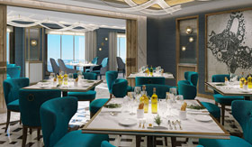Four square tables with four teal chairs with plates and bottles of olive oil