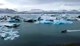 Zodiac boat surrounded by ice