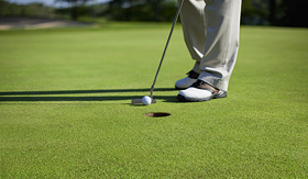Crystal Cruises golf tapping in a short putt