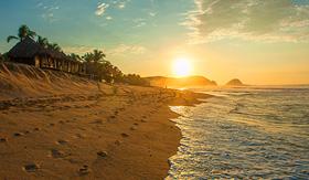 Cunard Line beautiful sunrise at Zipolite beach in Mexico
