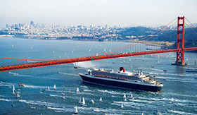 Cunard Line Queen Mary 2 sailing under San Francisco bridge