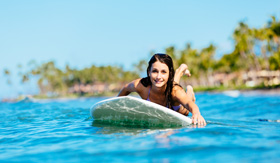 Hawaii Cruisetours, Woman Surfing in Hawaii, Paddling out to the Lineup