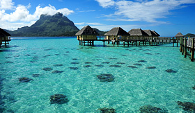 Holland America Line huts over the crystal clear water of Bora Bora the paradise