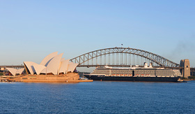 Holland America Line ship passing under Sydney Harbour bridge