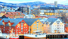 Holland America Line view of Tromso cityscape at dusk Norway