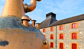 Holland America Line whiskey distillery in Ireland with old copper kettle