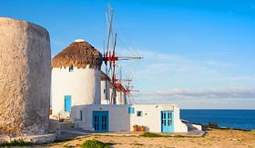 Holland America Line windmills on a hill near the sea on Mykonos