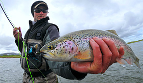 Norwegian Cruise Line fly fisher catches rainbow trout in Alaska