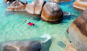 Norwegian Cruise Line man snorkeling at the Baths Virgin Gorda British Virgin Islands