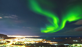Norwegian Cruise Line Northern Lights above Reykjavik, Iceland