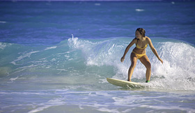 Norwegian Cruise Line young woman surfing