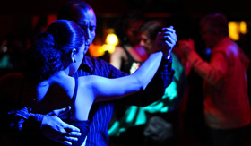 Couple dancing tango closely together