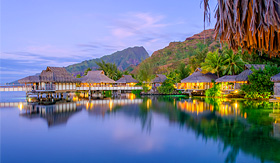 Princess Cruises overwater bungalows at dusk French Polynesia