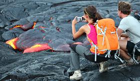 Princess Cruises tourists taking photo of lava from Kilauea volcano around Hawaii Volcanoes National Park USA