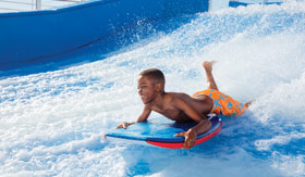 Young Child Surfing Waves on the Flowrider onboard Mariner of the Seas