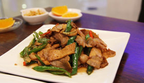 Plate of sichuan style pork and vegetables