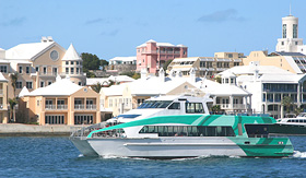 Regent Seven Seas Cruises passenger ferry running along the waterfront in Hamilton Bermuda