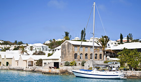 Regent Seven Seas Cruises sailing ship along the waterfront of the town of St Georges Bermuda