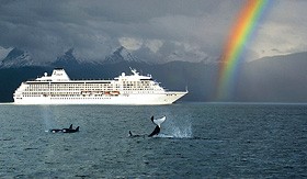Regent Seven Seas Cruises Seven Seas Mariner with rainbow and Orca whales