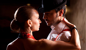 Royal Caribbean man and a woman dancing Argentinian tango