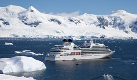 Seabourn ship sailing near glaciers
