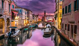 Sunset over a Venice waterway
