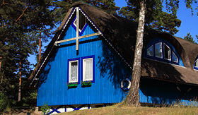 Seabourn Lithuania Klaipeda typical colorful wooden home with thatched roof
