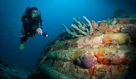 Silversea Cruises diver examines a wreck, Bonaire, Netherlands Antilles