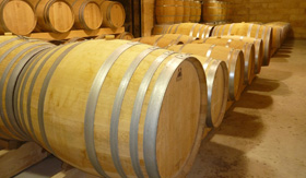 Brown barrels of wine in cellar