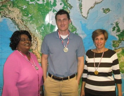 Cruise Consultant Medal Winners from left to right: Gloria, Brandon & Linda