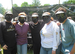 "Team ""Carnival Blue"" prepares for their paintball match."