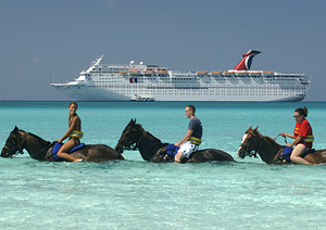 Horseback riding on the beach, courtesy of Carnival Cruise Lines