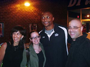 Cruise Web consultants pose with retired running back Eddie George.