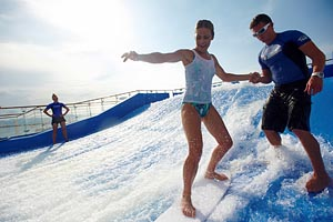 Practicing surfing on Royal Caribbean's FlowRider