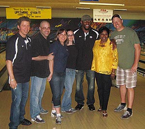 Cruise Web team members and Kathy Donnelly of Carnival Cruise Lines pose with Ray Lewis and friends