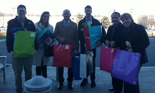 Cruise Web employees delivering gifts