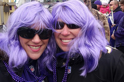 Cruise Consultant Morgan Mullinix and her sister dress up for the Ravens parade.