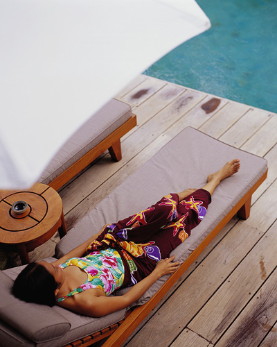 Woman Relaxing on Chaise Lounge