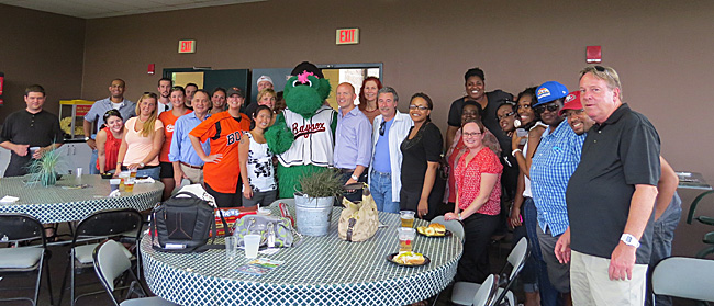 The Cruise Web team poses with Louie the Baysox mascot.
